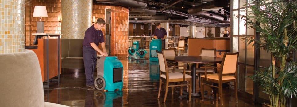 water damage restoration crew in restaurant