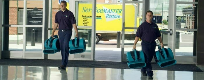 ServiceMaster's commercial cleaning services team walking in building