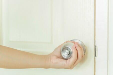 Hand on door handle