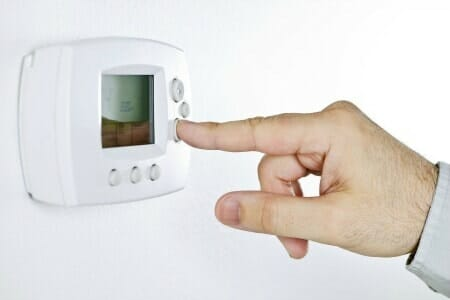 Finger on thermostat heating