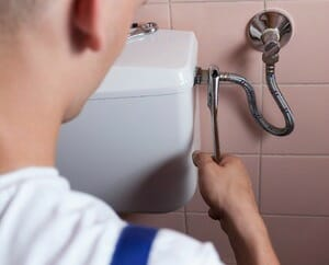 fixing leaking toilet plumber