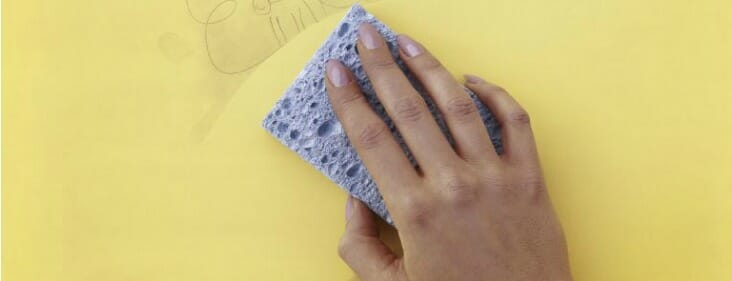 cleaning wall with sponge