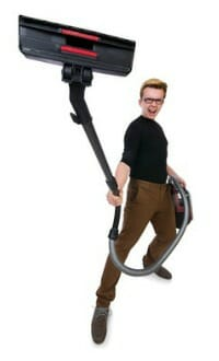 young man vacuum cleaner