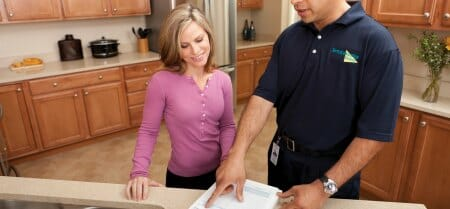servicemaster tech with customer