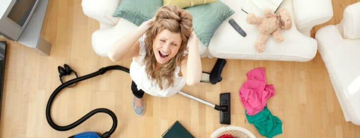 frustrated woman cleaning house