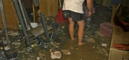 man in flooded basement