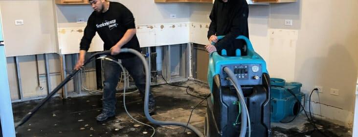 servicemaster team repairing water damaged home