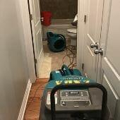 flood damage drying equipment in chicago bathroom