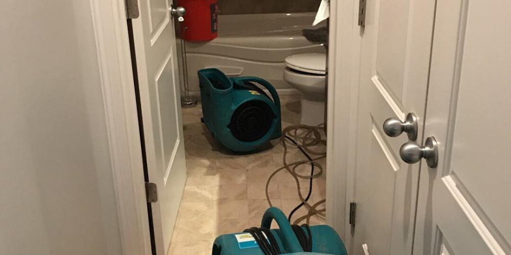 burst pipe bathroom damage