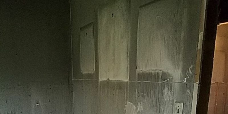 film on wall due to protein fire